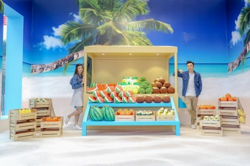 Tropical fruits such as coconuts, pineapples, watermelons, and bananas are included in the Caribbean Fruit Stand.